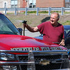 Volunteer Fireman Ray Buxton washes a Newfields Fire-Rescue truck prior to the start of the Newfields Memorial Day Parade and Picnic honoring Veterans for their service to our country on Saturday 5-28-2016, Newfields, NH.  Matt Parker Photos