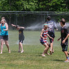 Kids play in the spray from the fire hoses at the Newfields Memorial Day Parade and Picnic honoring Veterans for their service to our country on Saturday 5-28-2016, Newfields, NH.  Matt Parker Photos