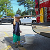 2 year old Levi Rowe gets a workout helping to wash the Newfields Fire Rescue trucks in preparation for the Newfields Memorial Day Parade and Picnic honoring Veterans for their service to our country on Saturday 5-28-2016, Newfields, NH.  Matt Parker Photos