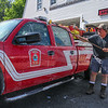 Scott Buxton of the  Newfields Volunteer Fire and Rescue scrubs the trucks in preparation for the Newfields Memorial Day Parade and Picnic honoring Veterans for their service to our country on Saturday 5-28-2016, Newfields, NH.  Matt Parker Photos