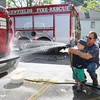 2 year old Levi Rowe helps his Grandfather Keith Rowe wash the Newfields Fire Rescue trucks in preparation for the Newfields Memorial Day Parade and Picnic honoring Veterans for their service to our country on Saturday 5-28-2016, Newfields, NH.  Matt Parker Photos