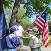Veteran Lee Baxter gives instructions to scouts, son Benjamin (L) and Christian Wilhelm on how to carry the flags in the Memoral Day Parade on Saturday at the Newfields Memorial Day Parade and Picnic honoring Veterans for their service to our country on 5-28-2016, Newfields, NH.  Matt Parker Photos