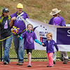 Cancer survivor 7 year old Lily Hamel of Newmarket, NH, leads the opening Cancer Survivor Lap holding hands with Hailey Mason at the American Cancer Society of New Hampshire 2016 Seacoast Relay for Life Cancer walk on Saturday 6-11-2016 @ Winnacunnet High School.  Matt Parker Photos
