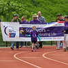 Cancer survivor 7 year old Lily Hamel of Newmarket, NH, leads the opening Cancer Survivor Lap at the American Cancer Society of New Hampshire 2016 Seacoast Relay for Life Cancer walk on Saturday 6-11-2016 @ Winnacunnet High School.  Matt Parker Photos