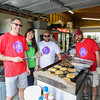 Brendan Markey, Liz Torrance, Joey Provencher and Alan Brown all of Kennebunk Savings Bank cook up a batch of pancakes and sausage to be served to the Cancer Survivor Relay Walkers at the 2016 Seacoast Relay for Life Cancer walk on Saturday 6-11-2016 @ Winnacunnet High School.  Matt Parker Photos