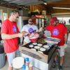 Brendan Markey, Joey Provencher and Alan Brown all of Kennebunk Savings Bank cook up a batch of pancakes and sausage to be served to the Cancer Survivor Relay Walkers at the 2016 Seacoast Relay for Life Cancer walk on Saturday 6-11-2016 @ Winnacunnet High School.  Matt Parker Photos