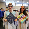 """Sarah Coffen with a quote from Carl Sagan, """"Somewhere, Something Incredible is waiting to be Known"""" and Megan Sico with the word, """"PRIDE"""" on her hat in support of the people who lost their lives in the Orlando Shooting at the Winnacunnet Class of 2016 Graduation Cermony on Friday 6-17-2016 @ WHS.  Matt Parker Photos"""