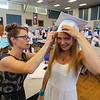 Winnacunnet teacher Kara Seager assits Gabbie Maclean with her hat prior to the start of the Winnacunnet Class of 2016 Graduation Cermony on Friday 6-17-2016 @ WHS.  Matt Parker Photos