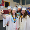 """Rachel Laroche takes a, """"selfi"""" with her friends (L to R) Lizzy Baker, Caitlyn Barbieri and Savannah McMenemy prior to the start of the  Winnacunnet Class of 2016 Graduation Cermony on Friday 6-17-2016 @ WHS.  Matt Parker Photos"""