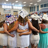 A group of soon to be graduates display their hats prior to the start of the Winnacunnet Class of 2016 Graduation Cermony on Friday 6-17-2016 @ WHS.  Matt Parker Photos