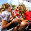 Miss New Hampshire's Caroline Carter paints a face at Sunday's Seacoast Salutes Military Appreciation Day sponsored by Seacoast Service Credit Union, Redhook Brewery and others on 7-24-2016, Redhook Brewery, Portsmouth, NH.  Matt Parker Photos