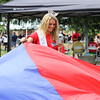 Miss New Hampshire Caroline Carter taking a video during a parachute game at Sunday's Seacoast Salutes Military Appreciation Day sponsored by Seacoast Service Credit Union, Redhook Brewery and others on 7-24-2016, Redhook Brewery, Portsmouth, NH.  Matt Parker Photos