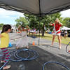 Miss New Hampshire's Caroline Carter works the hula hoop with a group of girls at Sunday's Seacoast Salutes Military Appreciation Day sponsored by Seacoast Service Credit Union, Redhook Brewery and others on 7-24-2016, Redhook Brewery, Portsmouth, NH.  Matt Parker Photos