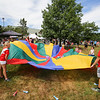 People participated in a Parachute game at Sunday's Seacoast Salutes Military Appreciation Day sponsored by Seacoast Service Credit Union, Redhook Brewery and others on 7-24-2016, Redhook Brewery, Portsmouth, NH.  Matt Parker Photos