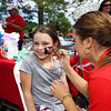 Mary Church of Derry gets a butterfly painted on her face by Miss Portsmouth's Sarah White at Sunday's Seacoast Salutes Military Appreciation Day sponsored by Seacoast Service Credit Union, Redhook Brewery and others on 7-24-2016, Redhook Brewery, Portsmouth, NH.  Matt Parker Photos
