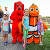 """3yr old Scout Lyford (L) poses for a phot with Isla (7 yr) and Evyn (5 yr) Christie of Hampton with Clifford, """"The Big Red Dog"""" and Nemo at the Lane Memorial Library Summer Reading Finale Party on Tuesday @ Centre School, Hampton, NH 8-2-2016.  Matt Parker Photos"""