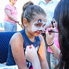 1st Grader Benten Lyford of Hampton has a Zebra painted on her face by face painting artist 8th Grader Katlyn Stewart at the Lane Memorial Library Summer Reading Finale Party on Tuesday @ Centre School, Hampton, NH 8-2-2016.  Matt Parker Photos