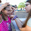 5th Grader Kayla Serafin has a rainbow painted on her face by face painting artist 8th Grader Abby Faulkingham at the Lane Memorial Library Summer Reading Finale Party on Tuesday @ Centre School, Hampton, NH 8-2-2016.  Matt Parker Photos