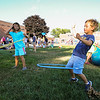 2nd Grader Emma Clifford and 1st Grader David Cuceu test their skills with a Hoolahoop at the Lane Memorial Library Summer Reading Finale Party on Tuesday @ Centre School, Hampton, NH 8-2-2016.  Matt Parker Photos