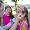 4th Grader Ella Murphy watches as 5th Grader Kayla Serafin has a rainbow painted on her face by face painting artist 8th Grader Abby Faulkingham at the Lane Memorial Library Summer Reading Finale Party on Tuesday @ Centre School, Hampton, NH 8-2-2016.  Matt Parker Photos
