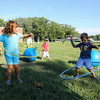 2nd Grader Emma Clifford and 1st Grader David Cuceu try their skills with a Hoolahoop at the Lane Memorial Library Summer Reading Finale Party on Tuesday @ Centre School, Hampton, NH 8-2-2016.  Matt Parker Photos