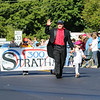 Stratham's Parade Marshall Dave Emanuel with daughter 4yr old Elly wave to the spectators as they lead the parade at the Stratham 300th Anniversary Parade on Sunday 9-25-2016, Stratham, NH.  Matt Parker Photos