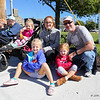Exeter's Dan and Kim Walsh with daughters, Mackenzie, Leah and Hailey get front row seats as they wait for the start of Stratham's 300th Anniversary Parade held on Sunday, 9-25-2016, Stratham Town Center-RT 33.  Matt Parker Photos