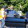 Stratham's Flossie Wiggin of the Parade Committee greats the spectators at Stratham's 300th Anniversary Parade held on Sunday, 9-25-2016, Stratham Town Center-RT 33.  Matt Parker Photos