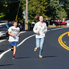 Stratham's Ryan O'Keefe and Sicilia Sturk jog down Rt. 33 having the road to themselves as Rt. 33 was closed to traffic in anticipation for the start of the Stratham 300th Anniversary Parade held on Sunday 9-25-2016, Stratham, NH.  Matt Parker Photos