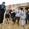 A group of guys with the signature Chucky's Fight fist pose at the 2016 Chucky's Fight Freezin' For a Reason New Years Eve Dip on Saturday 12-31-2016 @ Seabrook Beach, NH.  Matt Parker Photos