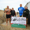 Chucky Rosa and wife Mary with Jesse Green (R) pose for a photo in front of a sign board at the 2016 Chucky's Fight Freezin' For a Reason New Years Eve Dip on Saturday 12-31-2016 @ Seabrook Beach, NH.  Matt Parker Photos