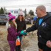 Chucky Rosa greets and welcomes a young girl to the 2016 Chucky's Fight Freezin' For a Reason New Years Eve Dip on Saturday 12-31-2016 @ Seabrook Beach, NH.  Matt Parker Photos