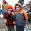 Two young boys, you came to support their family members, give the Chucky's Fight fist sign at the 2016 Chucky's Fight Freezin' For a Reason New Years Eve Dip on Saturday 12-31-2016 @ Seabrook Beach, NH.  Matt Parker Photos