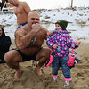 Chucky Rosa gets the eye from 2 year old Autumn Green as he works with her on the signature Chucky's Fight fist pose at the 2016 Chucky's Fight Freezin' For a Reason New Years Eve Dip on Saturday 12-31-2016 @ Seabrook Beach, NH.  Matt Parker Photos