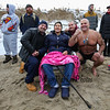 Brothers Tommy (L) and Chucky (R) with their father Domenic Rosa (center) with an unidentified man (red rear) at the 2016 Chucky's Fight Freezin' For a Reason New Years Eve Dip on Saturday 12-31-2016 @ Seabrook Beach, NH.  Matt Parker Photos