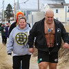 Chucky Rosa leads a group of people to the beach at the 2016 Chucky's Fight Freezin' For a Reason New Years Eve Dip on Saturday 12-31-2016 @ Seabrook Beach, NH.  Matt Parker Photos