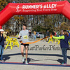 Kevin Greene #1425 of Waltham breaks the tape at the finish line taking 1st place with a time of 1:12:41 at the 12th Annual 2017 Seacoast Half Marathon on Sunday, 11-12-2017, Portsmouth, NH.  Matt Parker Photo
