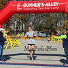 Kevin Greene #1425 of Waltham crosses the finish line taking 1st place with a time of 1:12:41 at the 12th Annual 2017 Seacoast Half Marathon on Sunday, 11-12-2017, Portsmouth, NH.  Matt Parker Photo