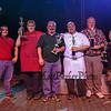 """Winners of the 2017 Hampton Firefighters Toy Bank Annual Chili Cook Off (L to R) Nate Ducharme of Bedford Fire, Nick Gannon of Millie's Tavern, Steven Graham with his Tony B's, Aaron Duvall of the 401 Tavern, Rusty Bridle with his """"Chamber Chili"""" and Heidi Gannon with her """"Chicken & Sweet Potato"""" on stage at Wally's Pub on Thursday 11-16-2017, Hampton Beach, NH.  Matt Parker Photos"""
