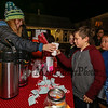 Emma Grant of the Depot Cafe' hands hot chocolate to 3rd grader Niko Orestis at the 2017 Annual Christmas Tree Lighting at the Gazebo at Marelli Square sponsored by the Hampton Parks & Recreation Department on Friday Night, Hampton, NH, 12-1-2016.  Matt Parker Photos