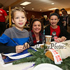 Stephanie Parron with her 4th grade son Chris and 7th grader Allison fill out raffle tickets at the 2017 Lights 4 Lives, Action for Aidan community fundraiser sponsored by the Stratham Volunteer Fire Department on Sunday 12-17-2017.  Matt Parker Photos