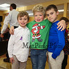 4th grader Aidan Carter poses for a photo with his friends 3rd grader Colby Flaim (L) and 4th grader Austin Hollasch at the 2017 Lights 4 Lives, Action for Aidan community fundraiser sponsored by the Stratham Volunteer Fire Department on Sunday 12-17-2017.  Matt Parker Photos