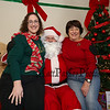 Chelsea Arsenault (L) and grandmother Jody Scamman pose for a photo with Santa at the 2017 Lights 4 Lives, Action for Aidan community fundraiser sponsored by the Stratham Volunteer Fire Department on Sunday 12-17-2017.  Matt Parker Photos