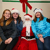 7th graders Marylou Marsden, Caroline Mollica and Bella Caracciolo pose for a photo with Santa at the 2017 Lights 4 Lives, Action for Aidan community fundraiser sponsored by the Stratham Volunteer Fire Department on Sunday 12-17-2017.  Matt Parker Photos