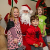 (L to R) 1st grader Avery and preschooler Owen Carter with 2nd grader Raegan Crowley get to sit on Santa's lap at the 2017 Lights 4 Lives, Action for Aidan community fundraiser sponsored by the Stratham Volunteer Fire Department on Sunday 12-17-2017.  Matt Parker Photos
