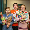 4th graders have their gifts wrapped and ready to go (L to R) Annay Nadeau, jack Riley and Alison Pouliot at the 2017 Annual Hampton PTA Breakfast with Santa on Saturday @ Hampton Academy on 12-9-2017.  Matt Parker Photos