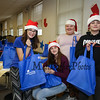Volunteers (L to R) 8th grader Hayley Newcomb, 6th grader Hanna Newcomb and 8th graders Maddy Torres and Jaycen Pickering worked at the Lend-A-Hands Food Drive sponsored by the Marston Student Council at the 2017 Annual Hampton PTA Breakfast with Santa on Saturday @ Hampton Academy on 12-9-2017.  Matt Parker Photos