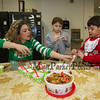 """Elfie"" Linda Durant helps 2nd graders Ella O'Brien and Nolan Durant make a bag of, ""reindeer food"" at the 2017 Annual Hampton PTA Breakfast with Santa on Saturday @ Hampton Academy on 12-9-2017.  Matt Parker Photos"