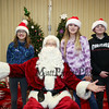 6th graders Haylie Lewis and Piper Coellner with 8th grader Jaycen Pickering pose for a photo with Santa Claus at the 2017 Annual Hampton PTA Breakfast with Santa on Saturday @ Hampton Academy on 12-9-2017.  Matt Parker Photos