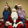 6th graders Haylie Lewis and Piper Coellner pose for a photo with Santa Claus at the 2017 Annual Hampton PTA Breakfast with Santa on Saturday @ Hampton Academy on 12-9-2017.  Matt Parker Photos